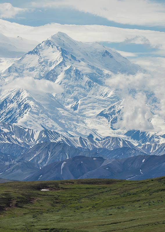 An expansive view of Denali, covered in snow.