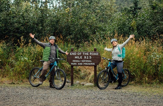 Two people on bicycles at the end of the Denali Park Road