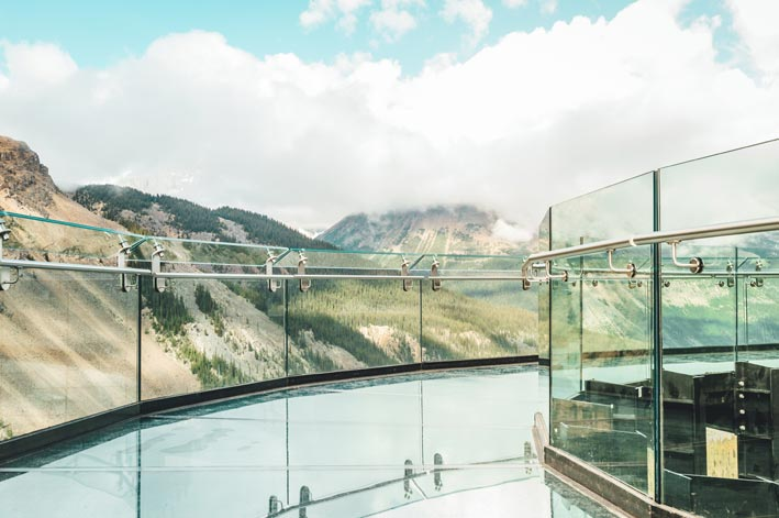 A glass platform above a forested valley