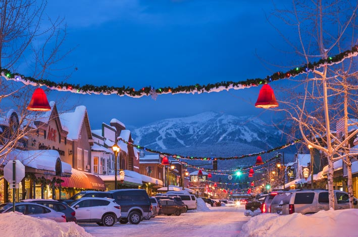 Christmas decorations and snow adorn Central Ave in Whitefish, MT