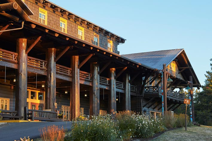 Sunlight shines on the wooden facade of the Glacier Park Lodge
